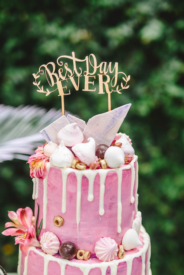 Pink cake with macarons and dripping icing | Jessilynn Wong Photography