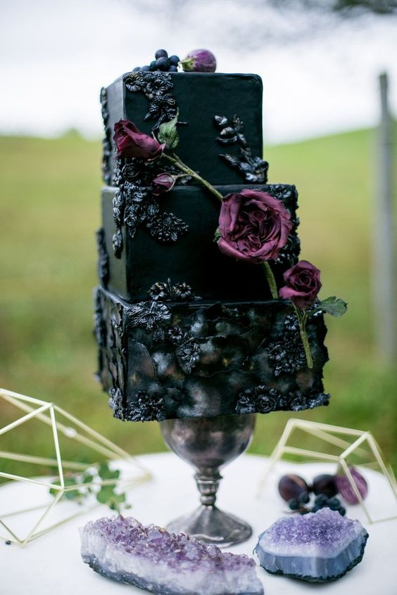 dramatic square wedding cake with flower and berry icing decor and fresh blooms