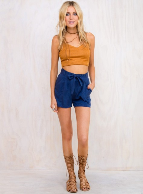With yellow crop top and lace up sandals