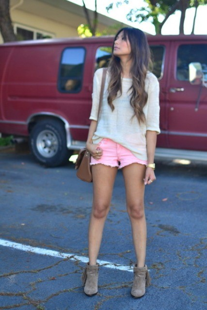 With white loose shirt, brown bag and gray boots