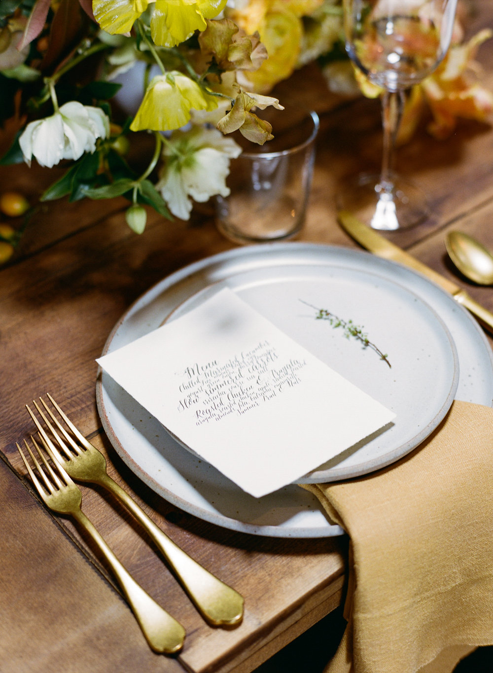 modern place settings - photo by Taken by Sarah Photography http://ruffledblog.com/intimate-rustic-chic-wedding-inspiration