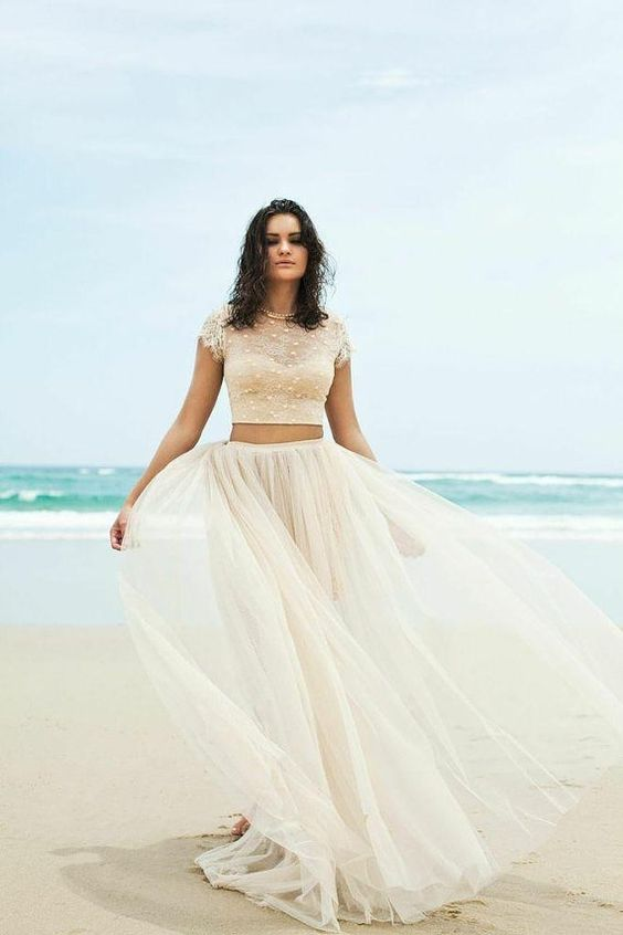 ivory flowy tulle skirt and a lace cap sleeve crop top with pearls