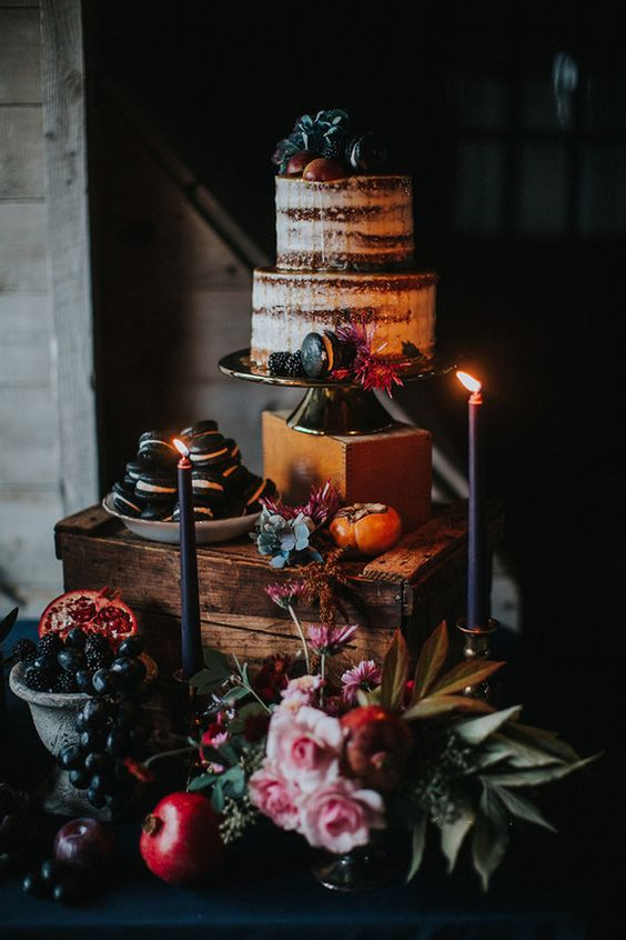 semi naked wedding cake with blackberries and black macarons