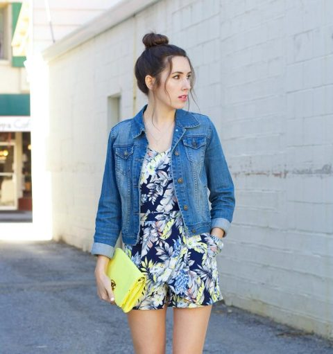 With denim jacket and yellow clutch