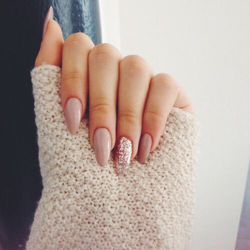 nude nails and a pink glitter accent one