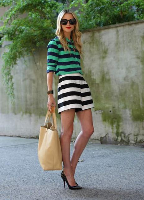 With green and navy blue striped shirt, black pumps and tote