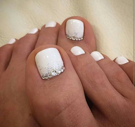 white nails with silver glitter and beads on the landing