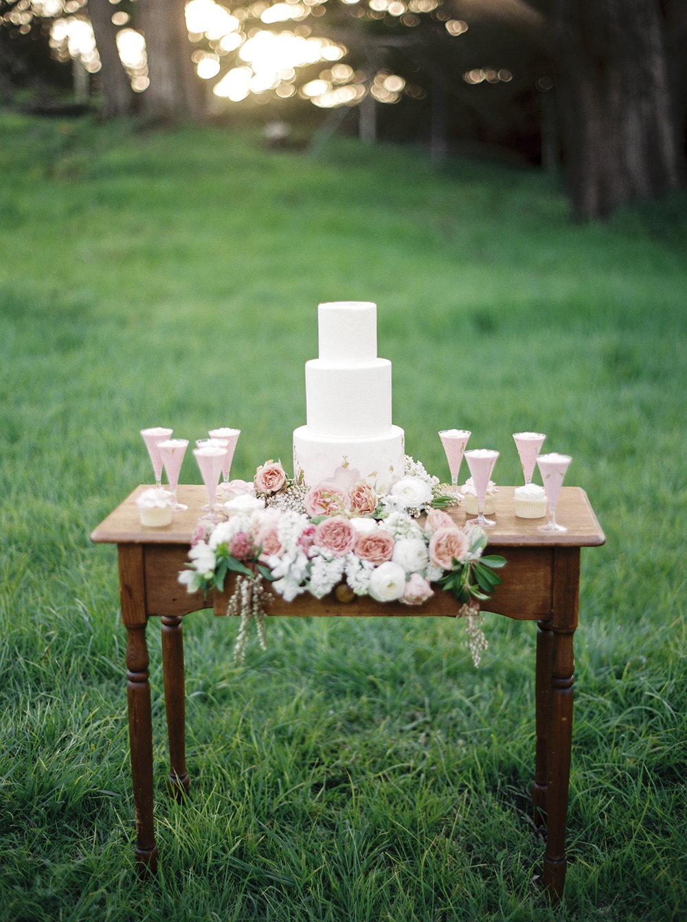 cake tables - photo by Tyler Rye Photography http://ruffledblog.com/romantic-coastal-california-wedding-inspiration