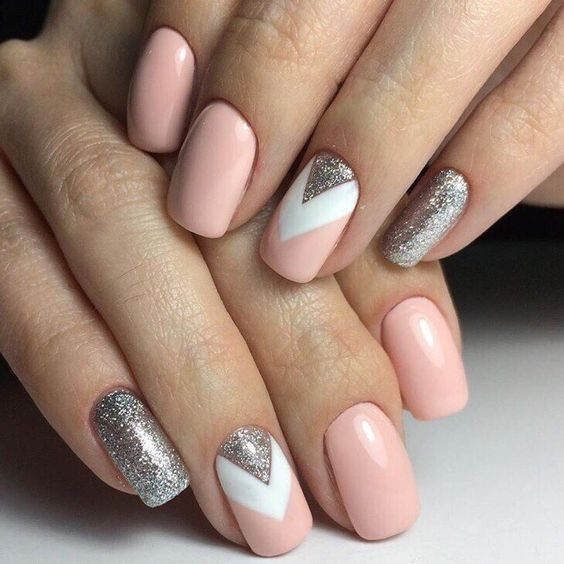 pink and silver glitter nails and an accent chevron nail in pink, silver and white