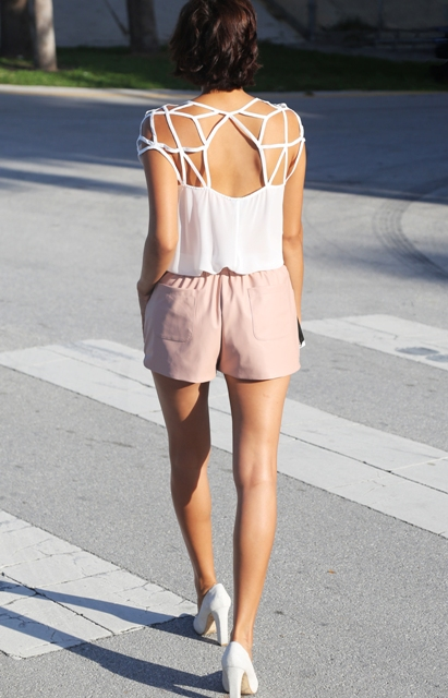 With unique top and white pumps