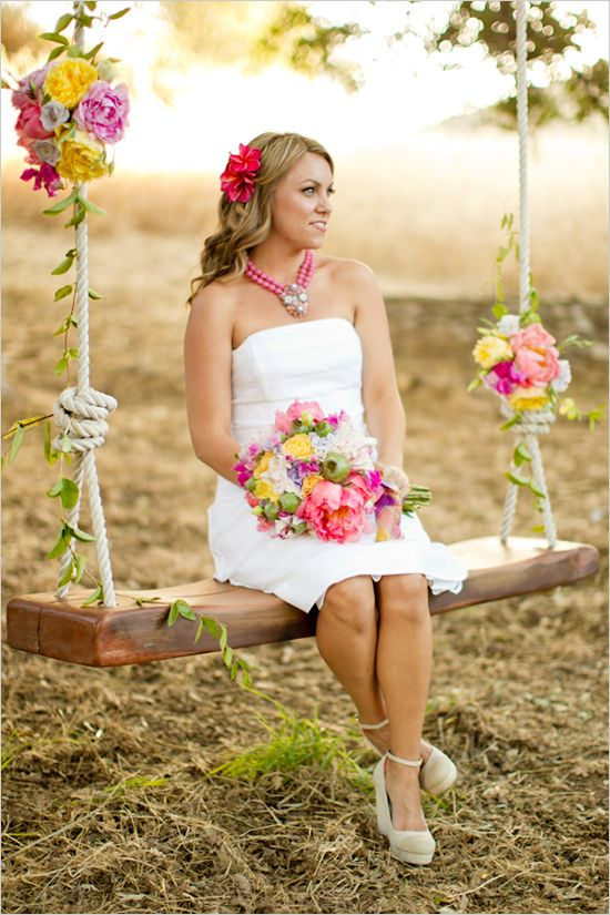 a rustic swing with bold blooms and some leaves