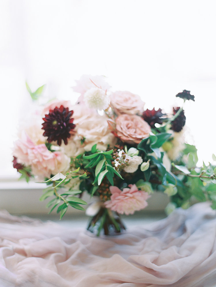bouquet with burgundy dahlias - photo by Bethany Erin Photography http://ruffledblog.com/modern-meets-rustic-wedding-in-dallas