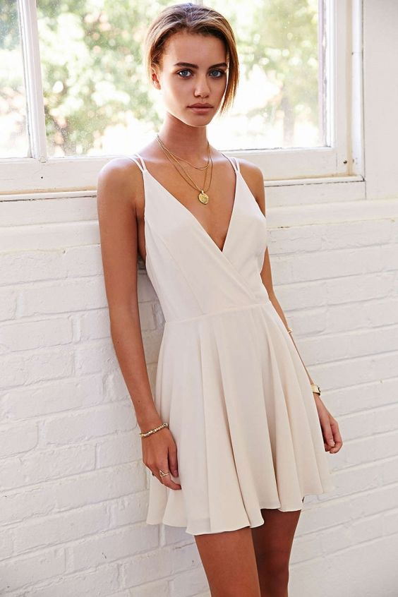 deep V-neck white mini dress with straps is a simple and elegant solution