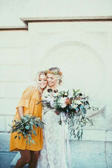 mustard bell dress with short lace sleeves and a pleated front for a bridesmaid