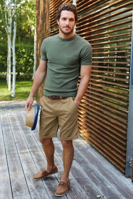 With olive green t-shirt, camel shorts and straw hat