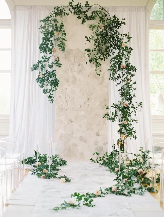marble wedding backdrop with greenery, blush flowers and candles