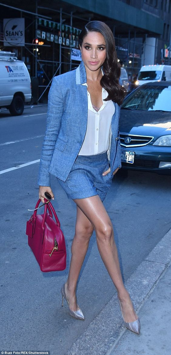 grey shorts suit, a white shirt, pumps and a fuchsia bag