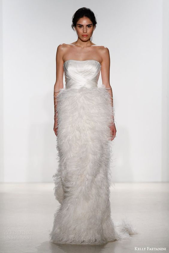 strapless draped bodice wedding dress with a fluffy feather skirt