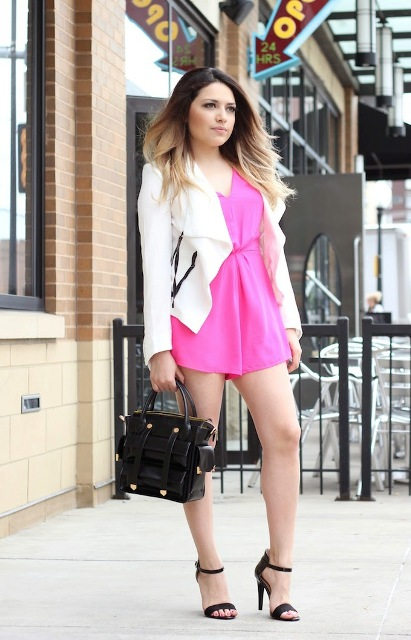 With white blazer, black bag and heels