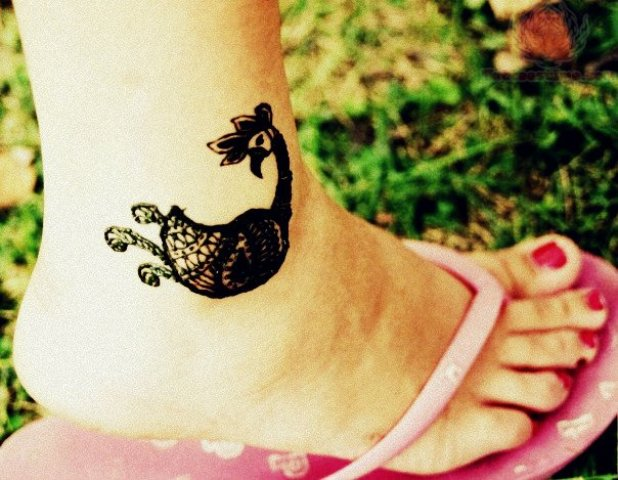 Small peacock tattoo on the ankle