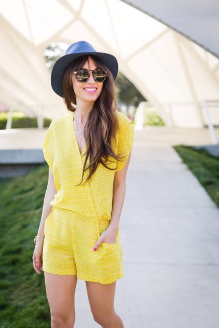 With hat and oversized sunglasses