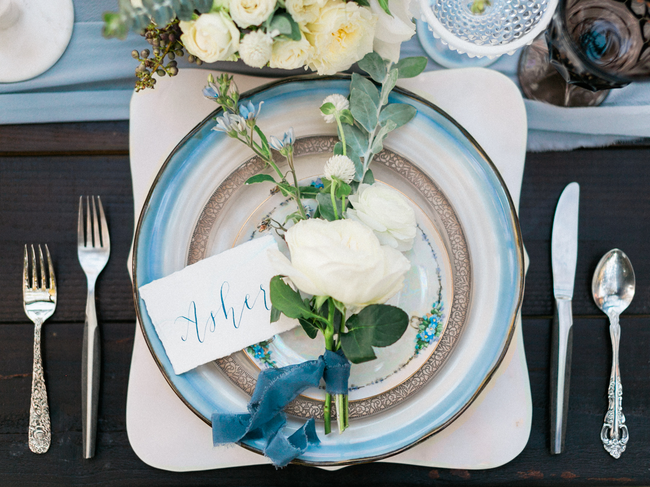 blue place settings - photo by Dennis Roy Coronel http://ruffledblog.com/copper-blue-rancho-las-lomas-wedding-inspiration