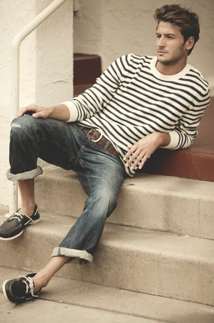 With striped shirt and cuffed jeans