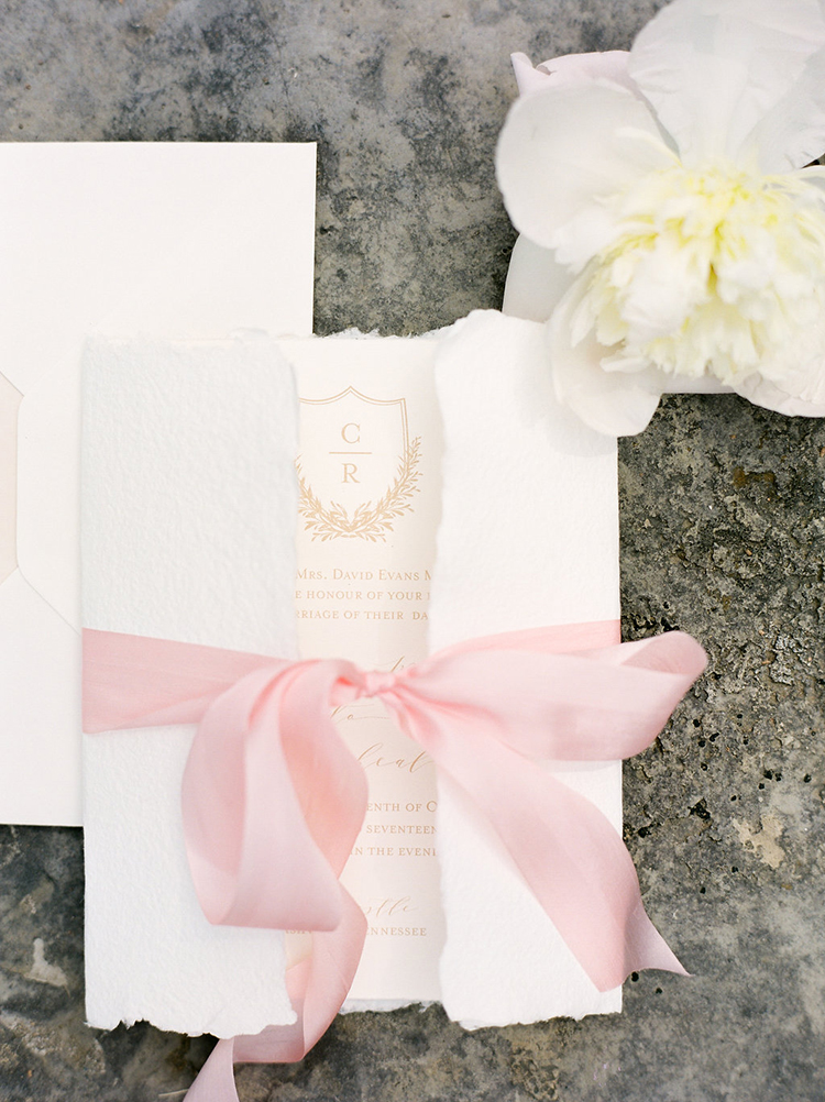 romantic torn paper wedding invitations - photo by Christy Wilson Photography http://ruffledblog.com/summer-castle-soiree-wedding-inspiration