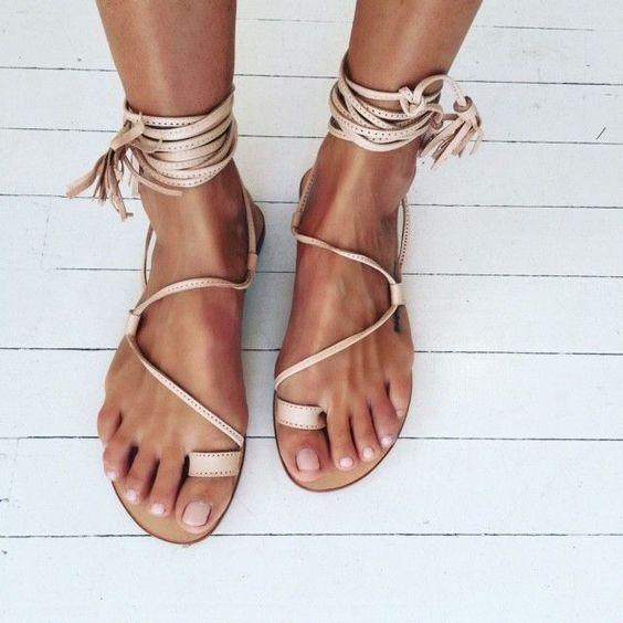 neutral gypsy-inspired lace up flat sandals with tassels