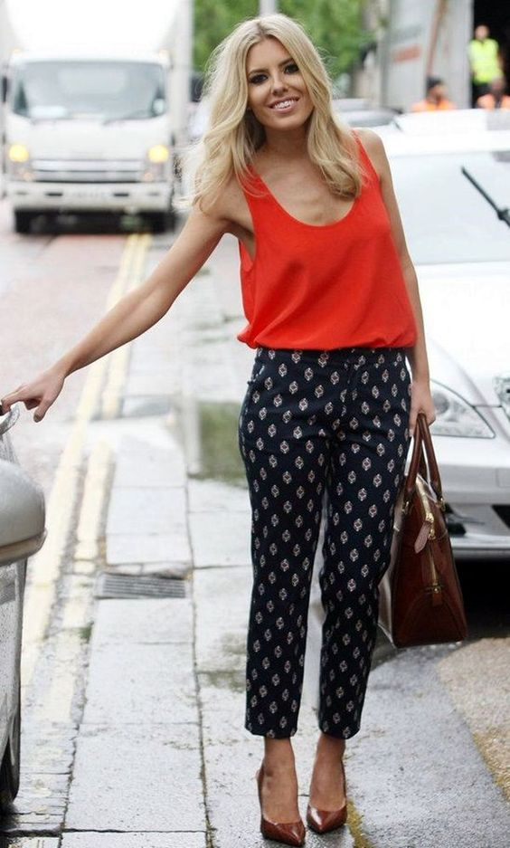 printed navy pants, a bold red strap top and brown shoes