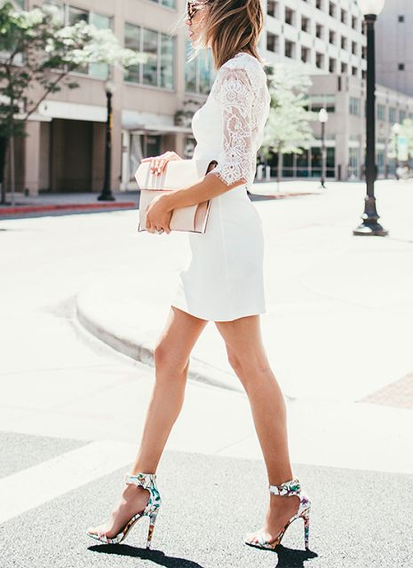 short white dress with lace half sleeves and colorful floral ankle strap heels
