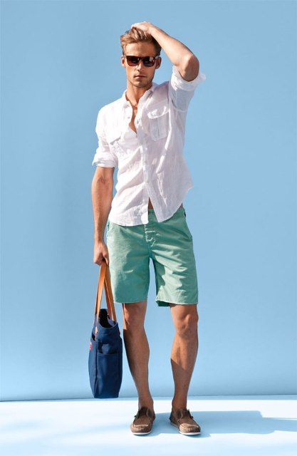 With white shirt, denim bag and mint green shorts