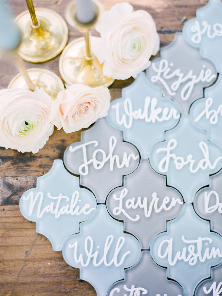 glass name cards - photo by Christy Wilson Photography http://ruffledblog.com/summer-castle-soiree-wedding-inspiration