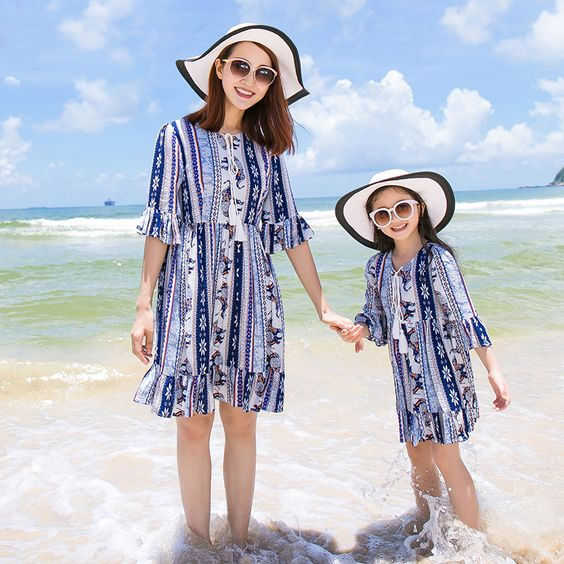 matching printed blue beach dresses for the mom and her girl
