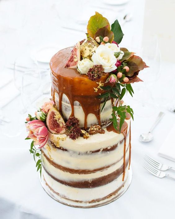 semi naked wedding cake with caramel drip, figs and fresh blooms and foliage