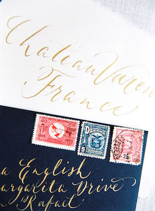 Gold calligraphy wedding invitations for a French chateau wedding | Zosia Zacharia Photography