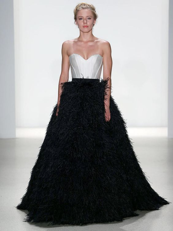 strapless sweetheart white bodice and a black feather full skirt for a daring bride