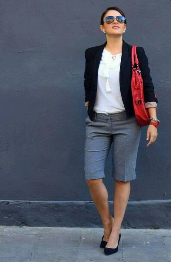 grey bermudas, a white top with tassels, a black blazer and suede pumps