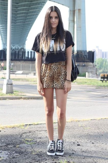 With black t-shirt, sneakers and black bag