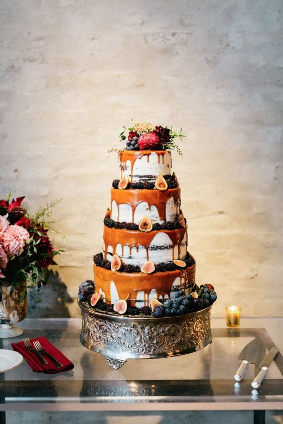 multi-layer drizzle wedding cake with caramel drip, blackberries, figs and topped with fresh blooms
