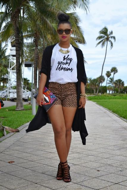 With white t-shirt, black long cardigan, printed clutch and black sandals