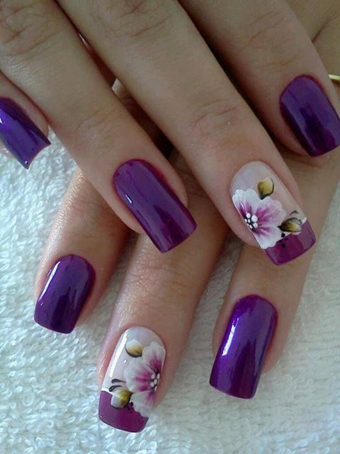 purple nails with large scale floral designs