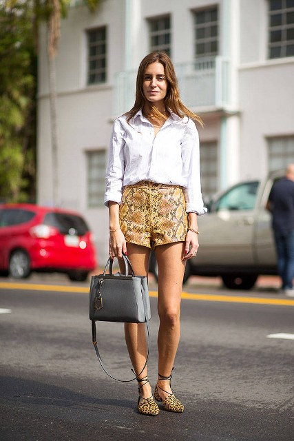 With white button down shirt, gray bag and leopard flats