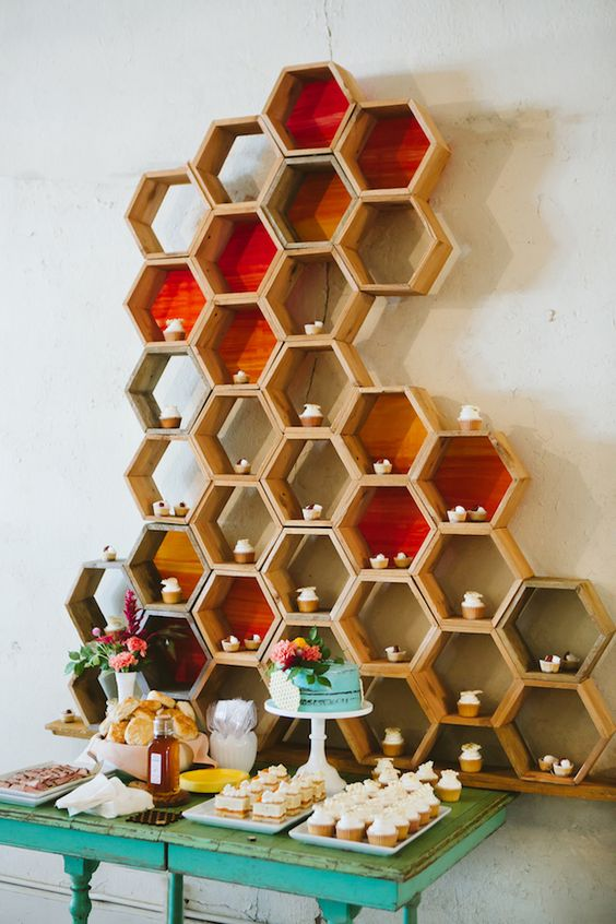 colorful hexagon dessert display with cupcakes looks unique