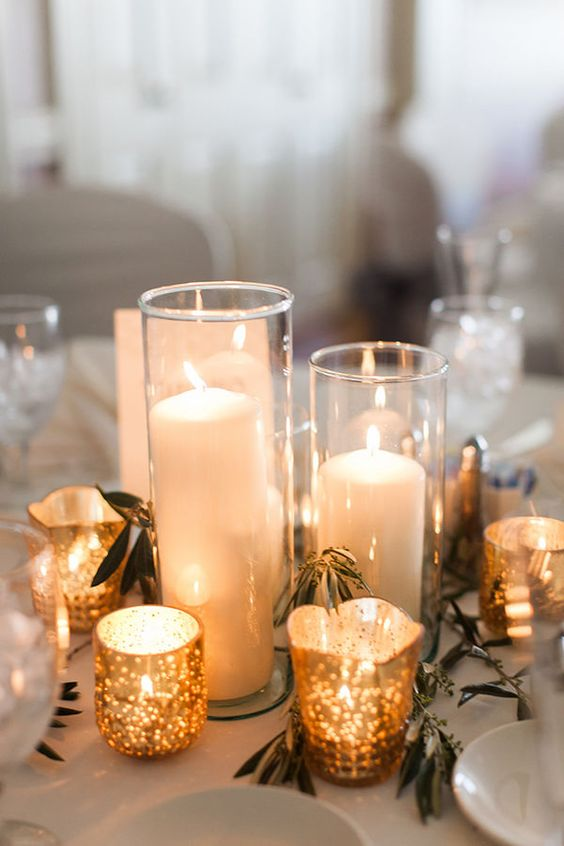 gold candle holders with transparent hurrican ones