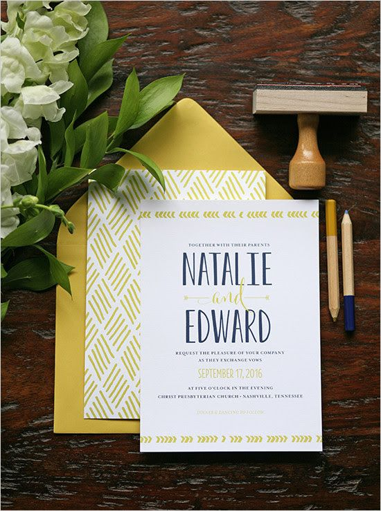 a mustard and navy invitation suite with geo prints and calligraphy