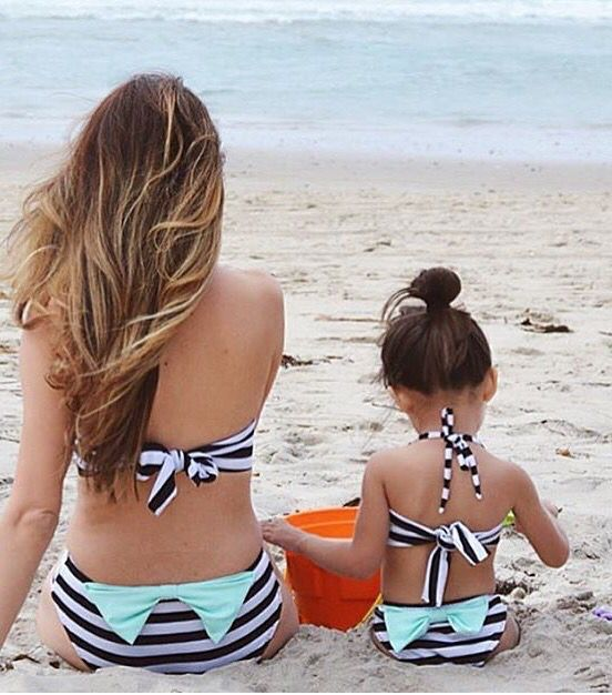 black and white striped two piece bathing suits with aqua bows