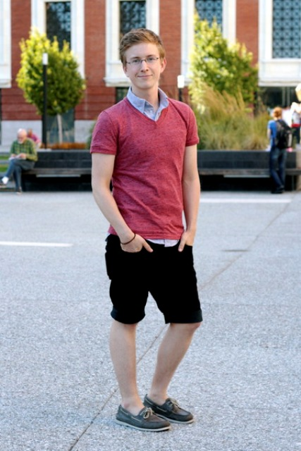 With blue shirt, red t-shirt and black shorts