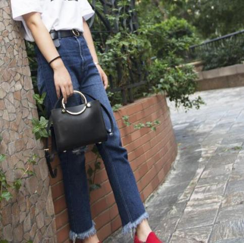 With white t-shirt, high-waisted jeans and red shoes