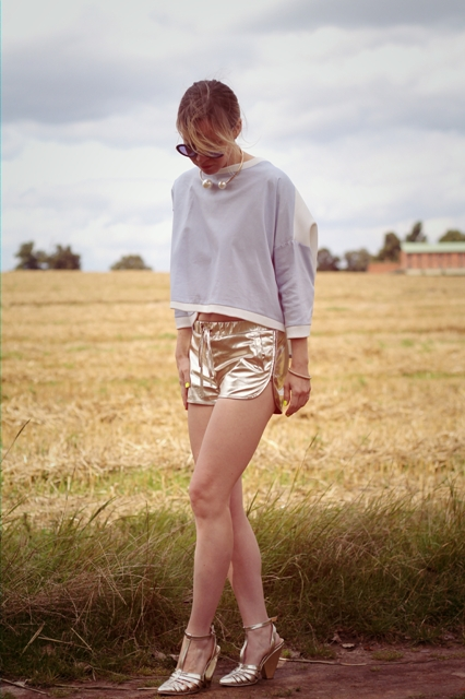 With loose crop shirt and metallic shoes